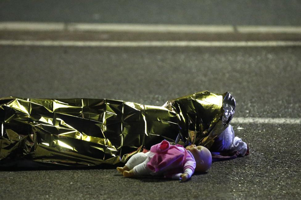 A body is seen on the ground after at least 30 people were killed in the southern French town of Nice when a truck ran into a crowd celebrating the Bastille Day national holiday