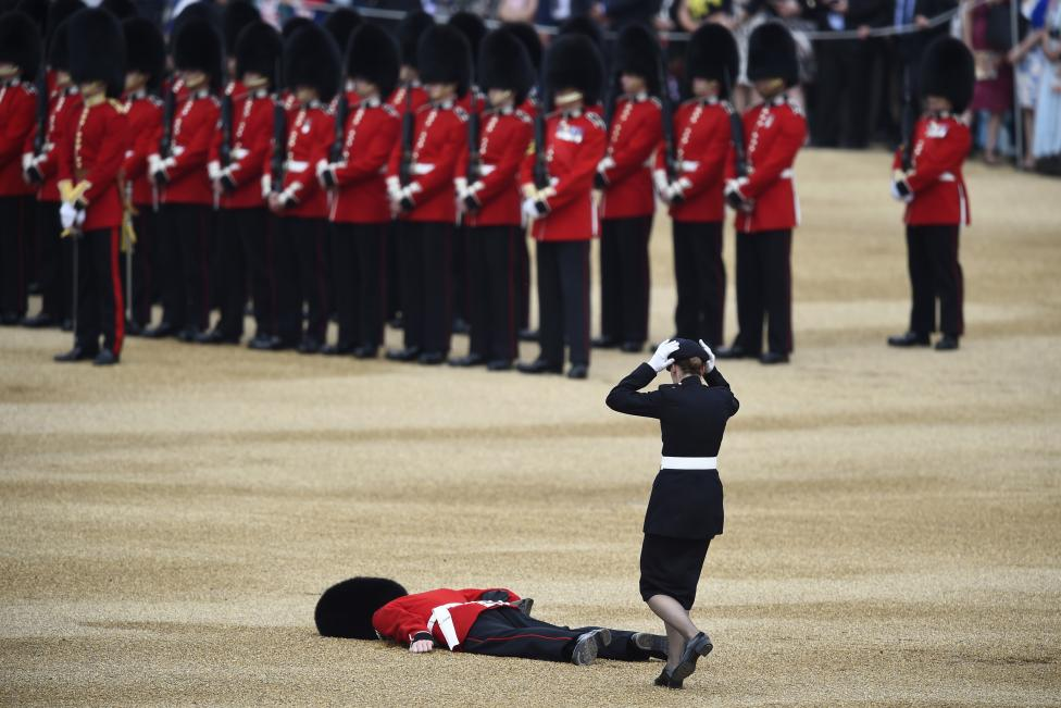 A Guardsman faints at Horseguards Parade for the annual Trooping the Colour ceremony in central London