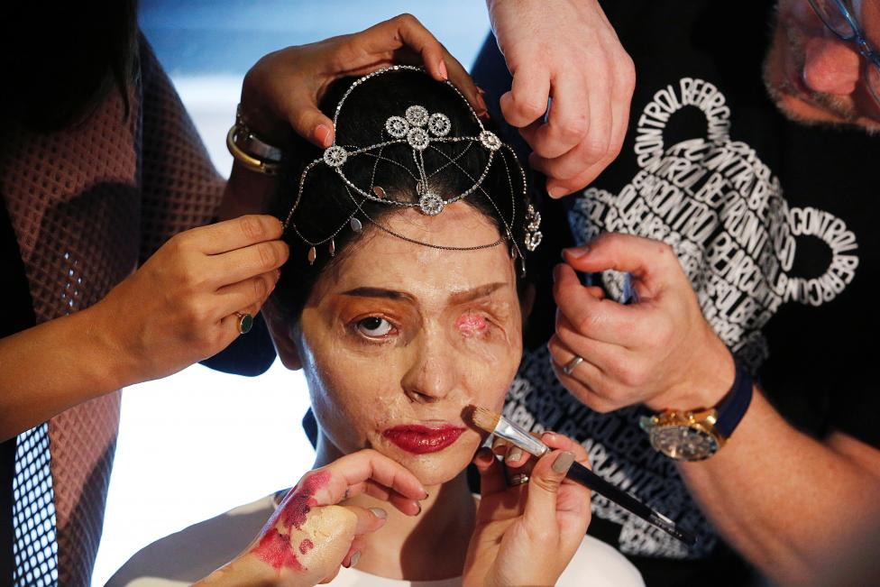 Indian model and acid attack survivor Reshma Quereshi has make up applied before walking to present Indian designer Archana Kochhar's Spring/Summer 2017 collections during New York Fashion Week in the Manhattan borough of New York